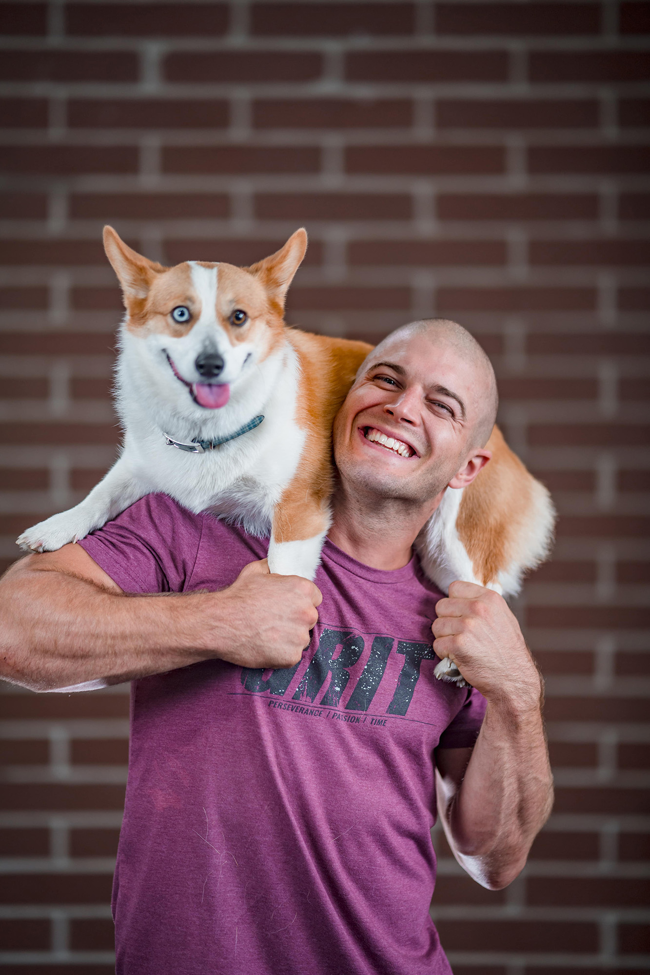 man holding dog talking about strength training program