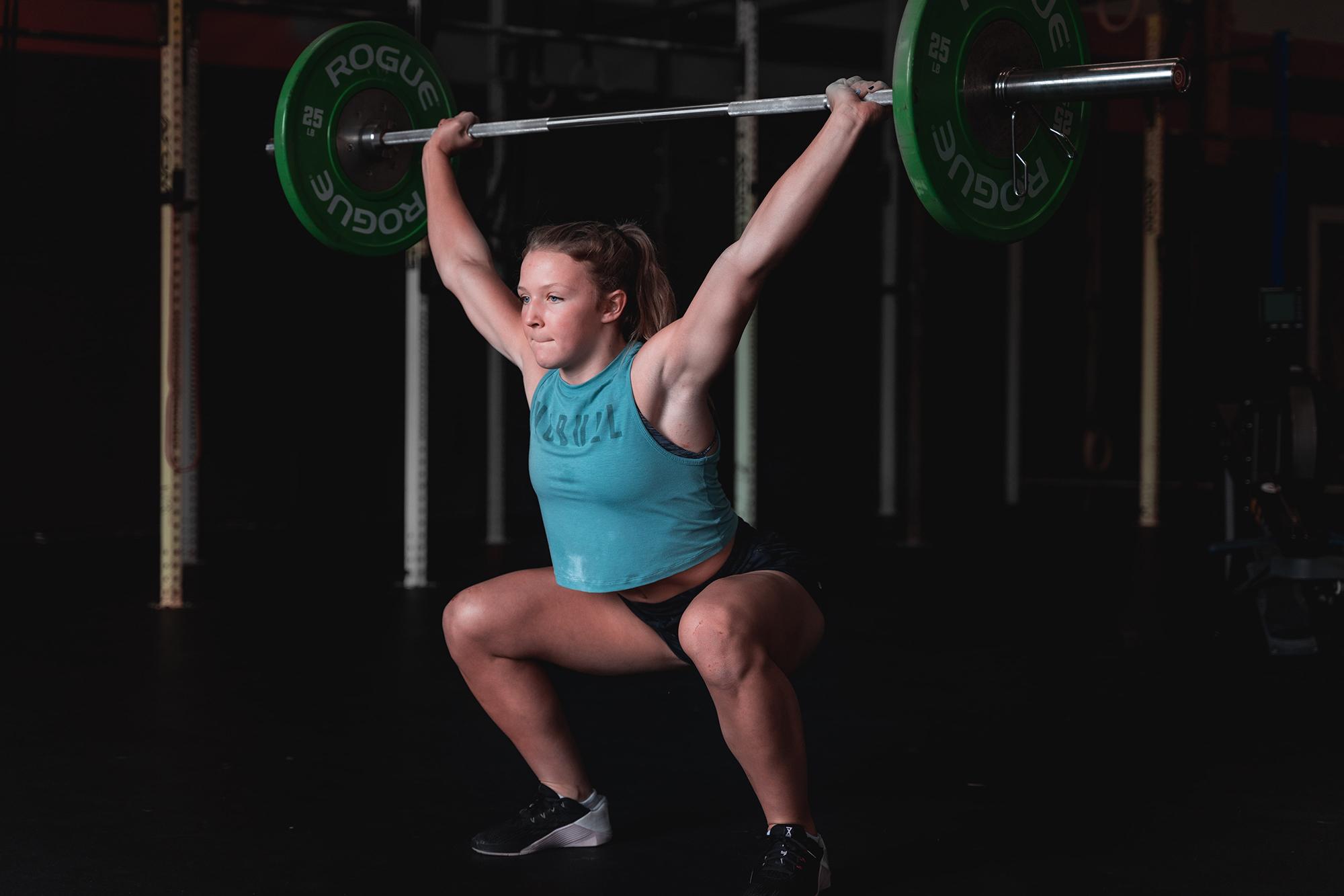 teen girl lifting weights, demonstrating teen fitness