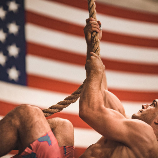 man climbing rope during a crossfit workout