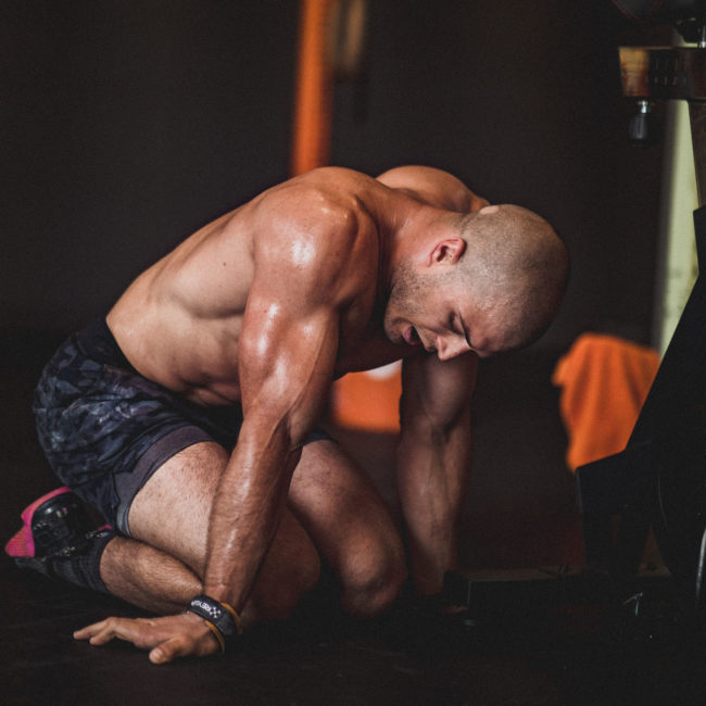 man resting after doing a workout