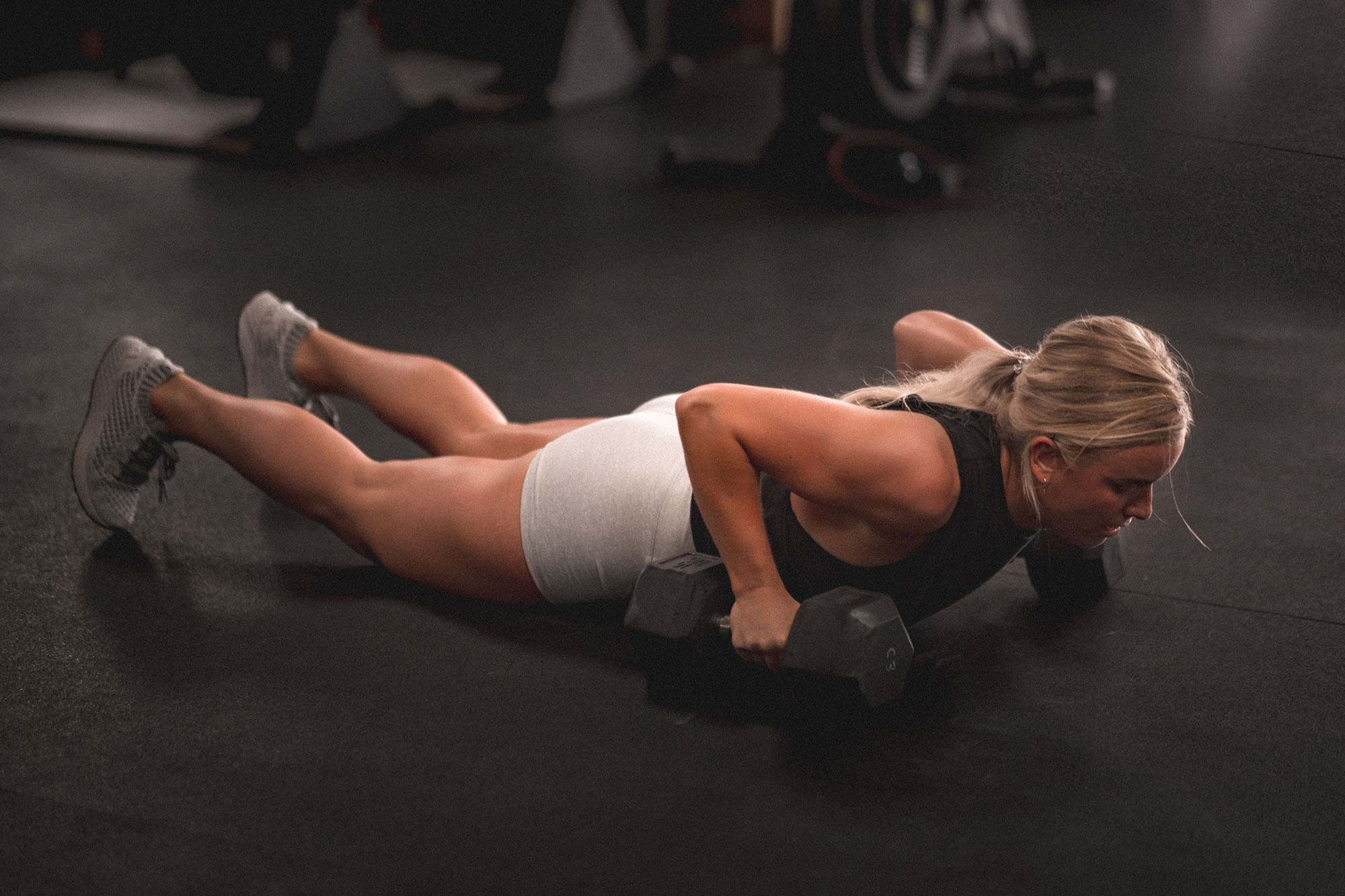 woman using weights working on strength training