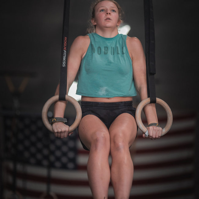 teen doing a crossfit workout on rings