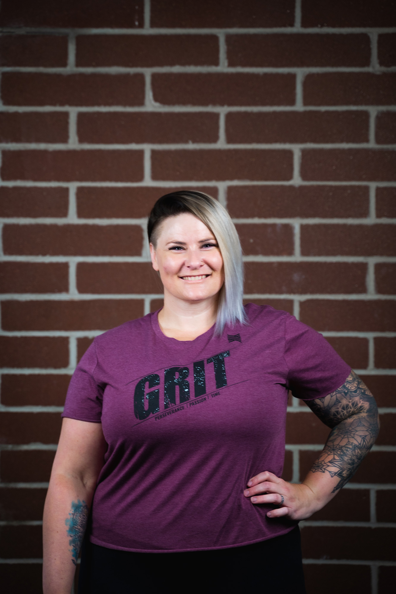 woman wearing Grit t-shirt who does at-home workout programs