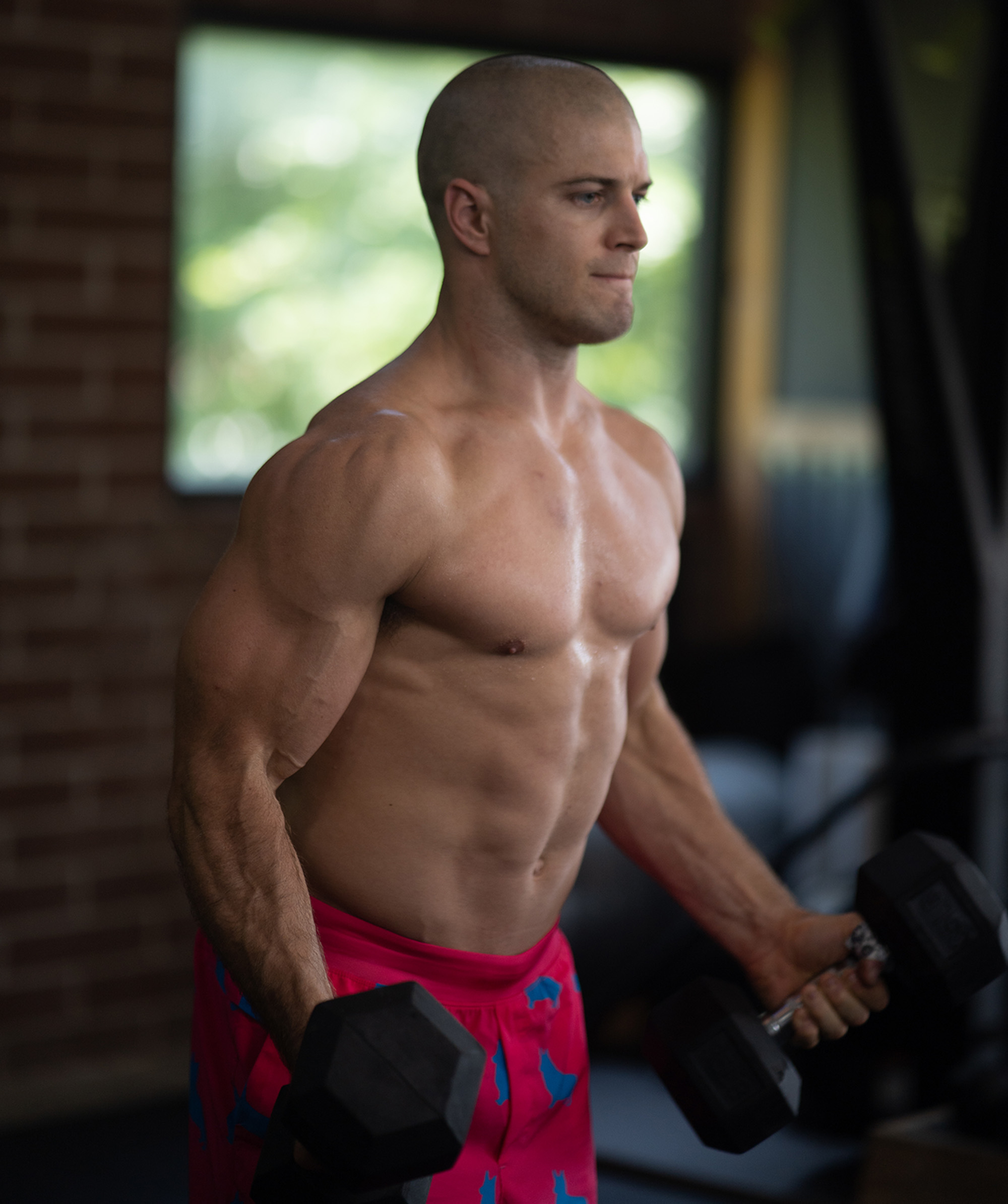 man with good physique practicing strength training